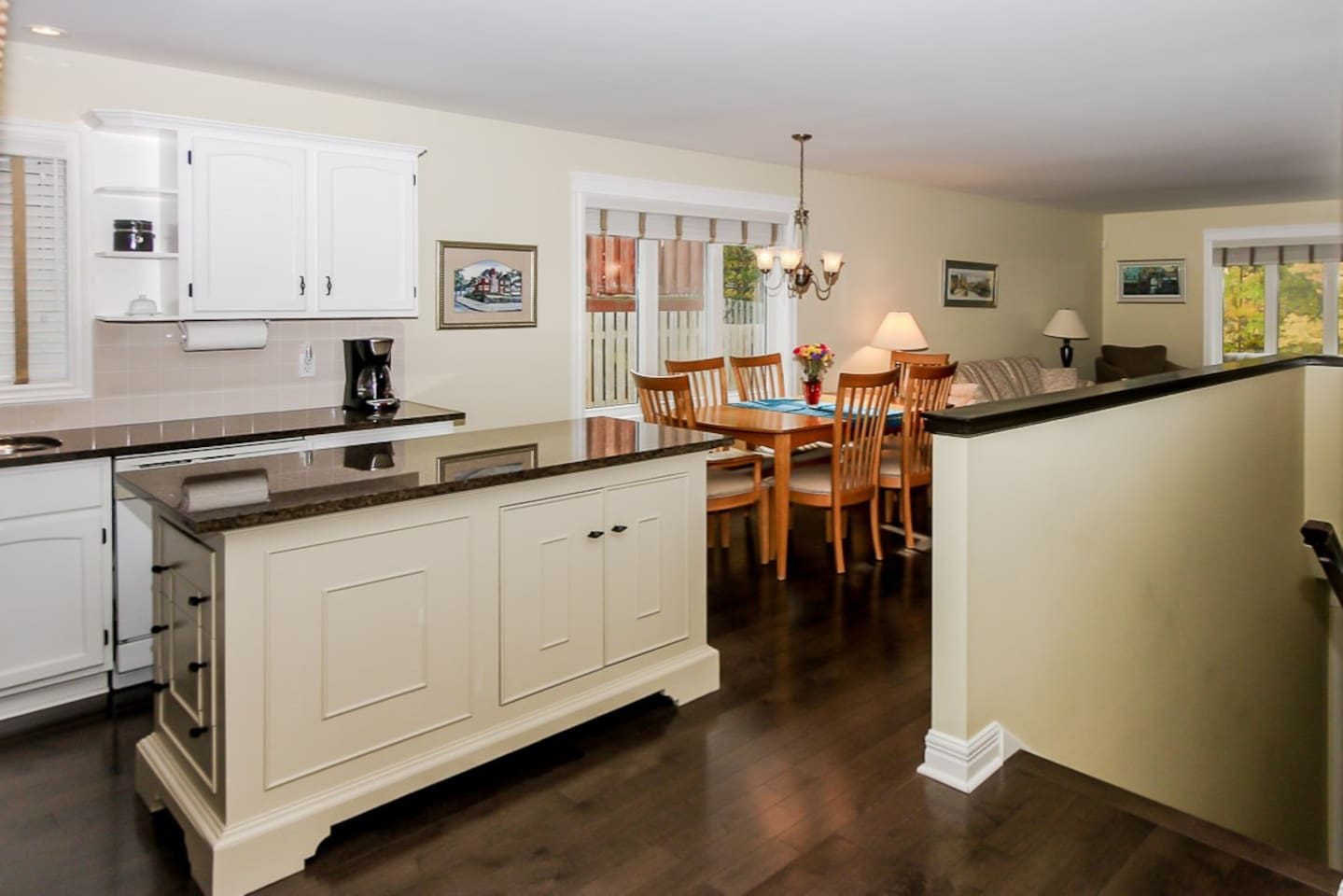 Open concept kitchen, dining and living room. Over 1000 square feet for your private use during your stay.