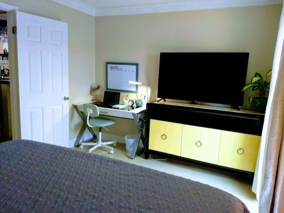 """This beautiful bedroom has a 55"""" smart TV and a office desk. Very comfortable for work or study."""