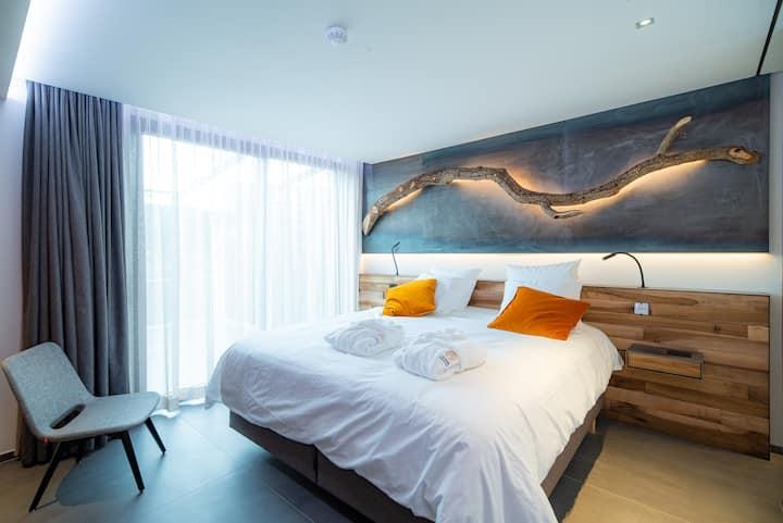 Chambre Deluxe avec terrasse et jacuzzi privatifs