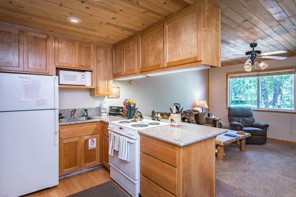 Meal prep is easy with a full suite of appliances, including a fridge, oven with 4-burner stove and microwave.