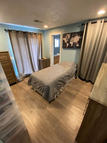 Guest bedroom has a twin bed, sliding glass door with deck access, and is attached to the second bathroom. I leave my clothes and shoes here when I travel, but you'll have plenty of space!