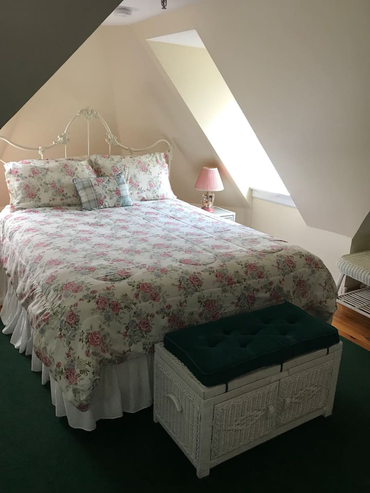 Tower Suite bedroom and through French doors to sitting room with sofa bed