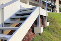 A second stairway on the oceanside leading up from the parking area to the infinity pool.