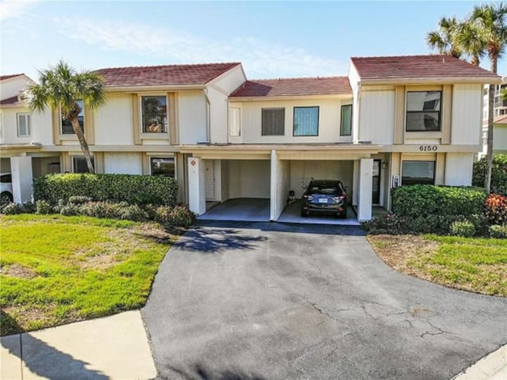 Stunning Isla Del Sol 2 story townhome and carport