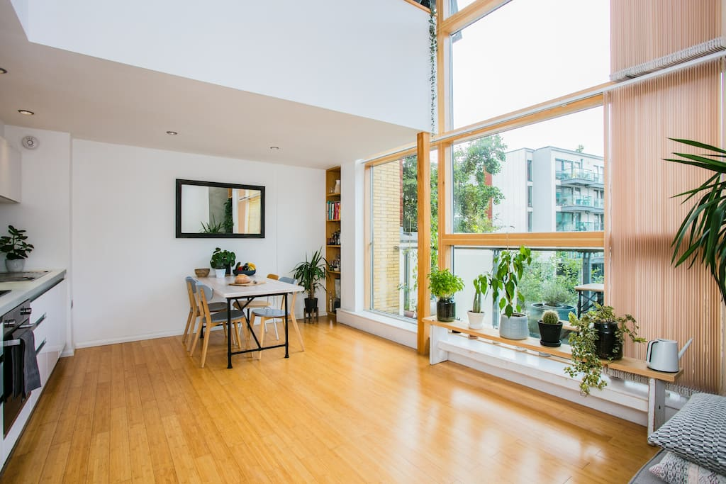 Double-height windows provide wonderful lighting throughout the day