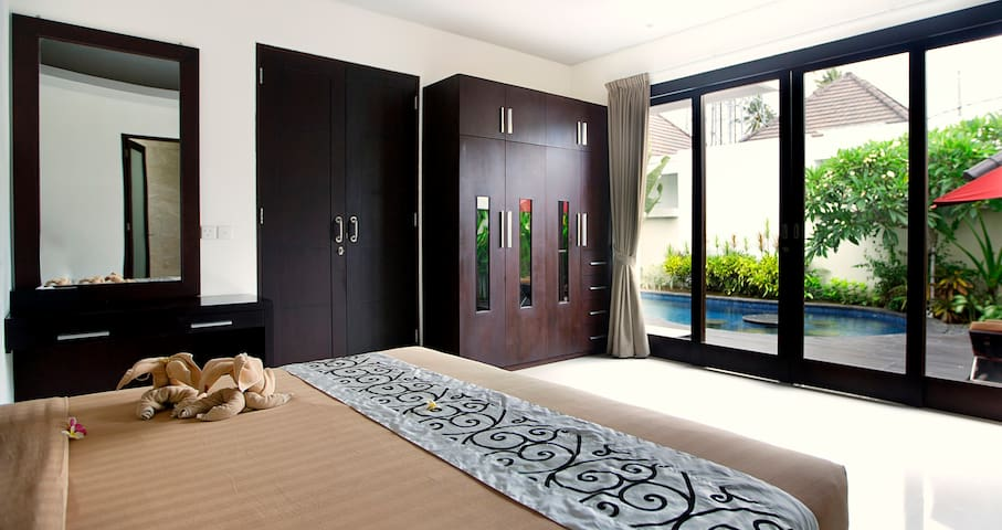 Each bedroom has a private access to the pool and outside area