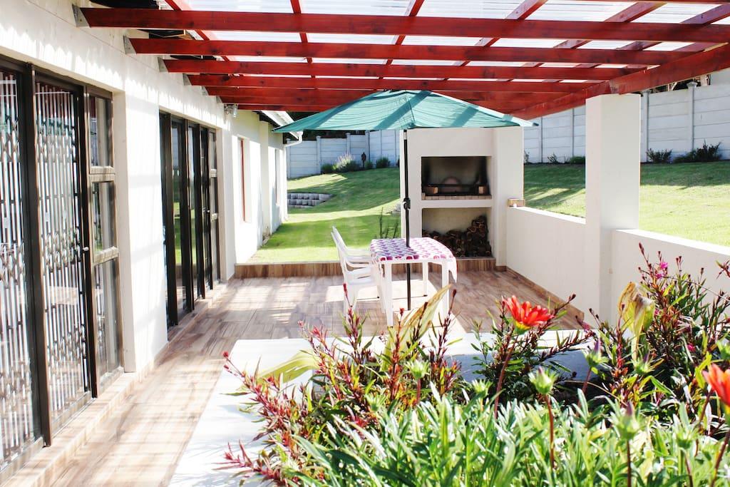 Sunny outdoor patio with built-in braai