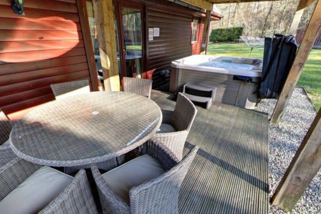 covered deck with hot tub, rattan garden furniture and BBQ