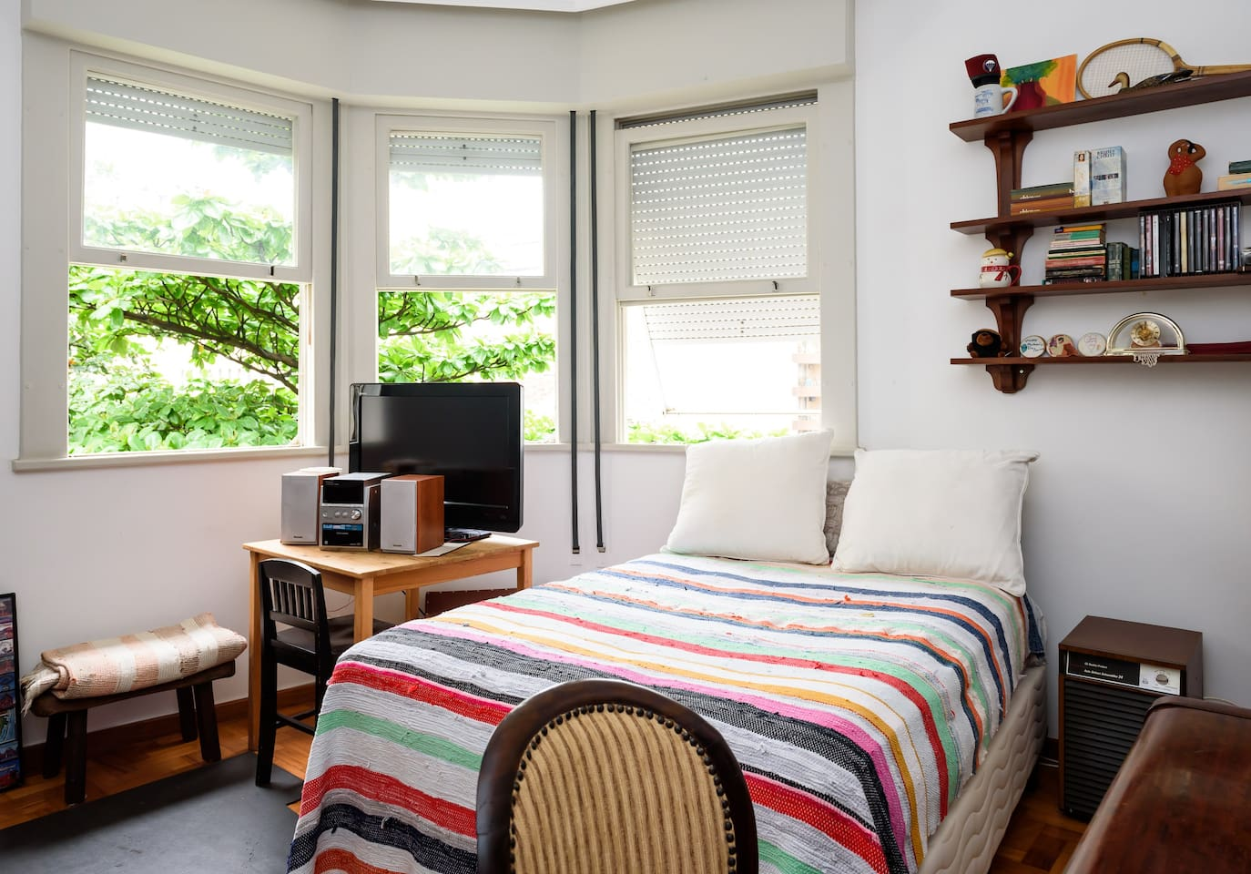 This is the guest room where you will be staying, with big bay windows.