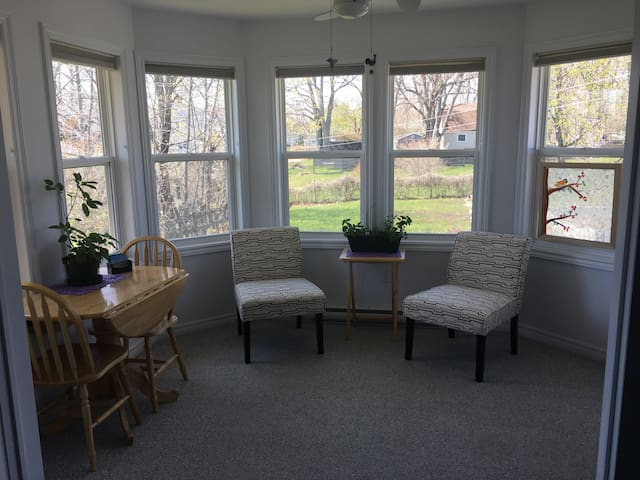 One bedroom + Sunroom!