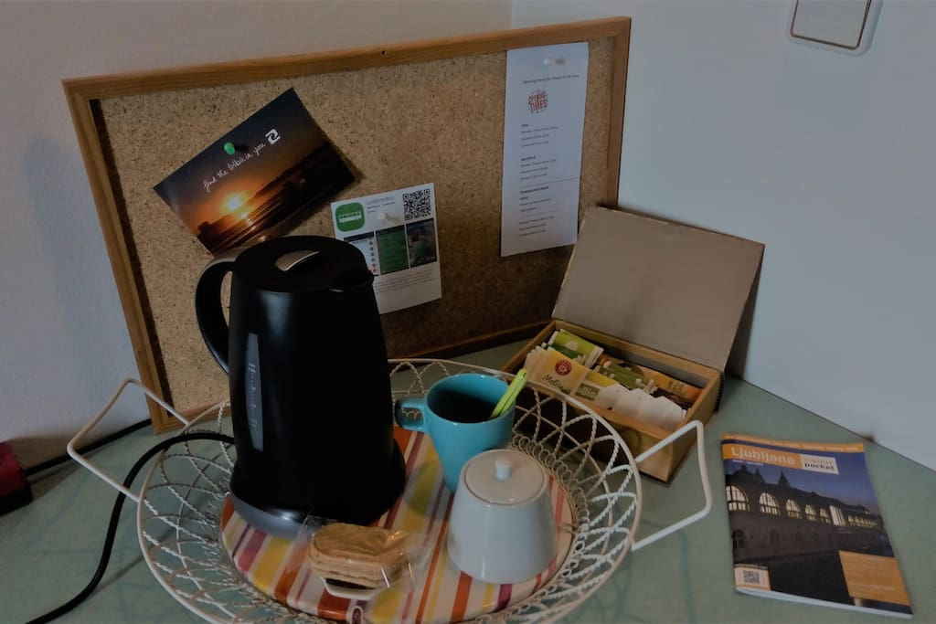 There is a kettle and selection of teas and coffee in the room.