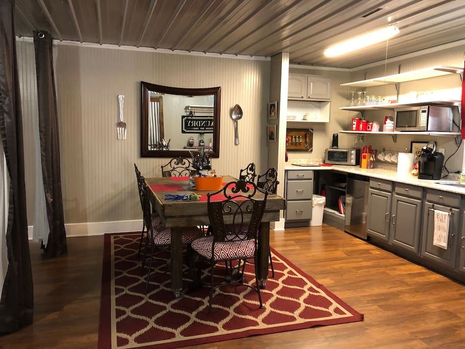 Kitchen and Dining Area to the right of twin beds.