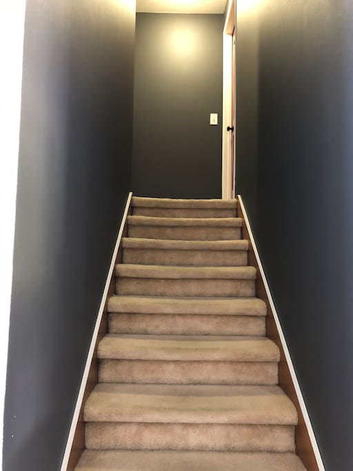 The hallway leading up the stairs. Your room in on the right at the top