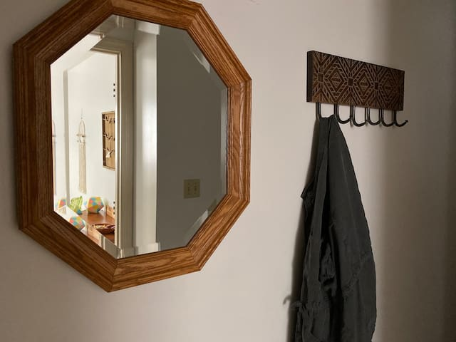 Entry with wall hooks for your convenience and mirror that bounces natural light.