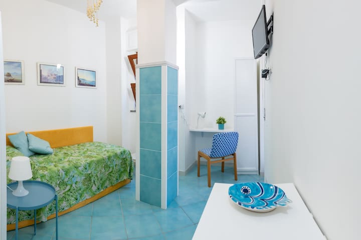 Bedroom 2 - Two Single Beds with Fresh Linens, Access to outside Terrace area, Air Conditioning, Free Wi-Fi 24hrs, Satellite TV