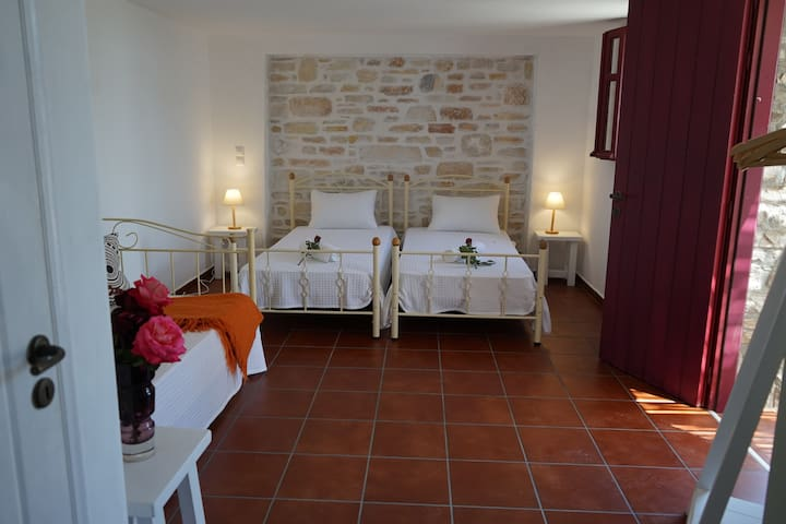 Bedroom with two single beds and a couch bed for an extra guest. Air-conditioned.