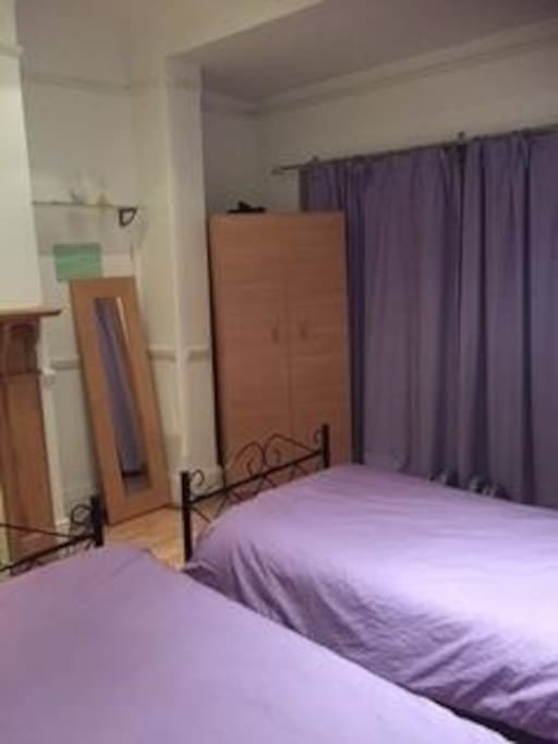 Double Bedroom with two single beds, wardrobe (hangers),  desk space for laptop