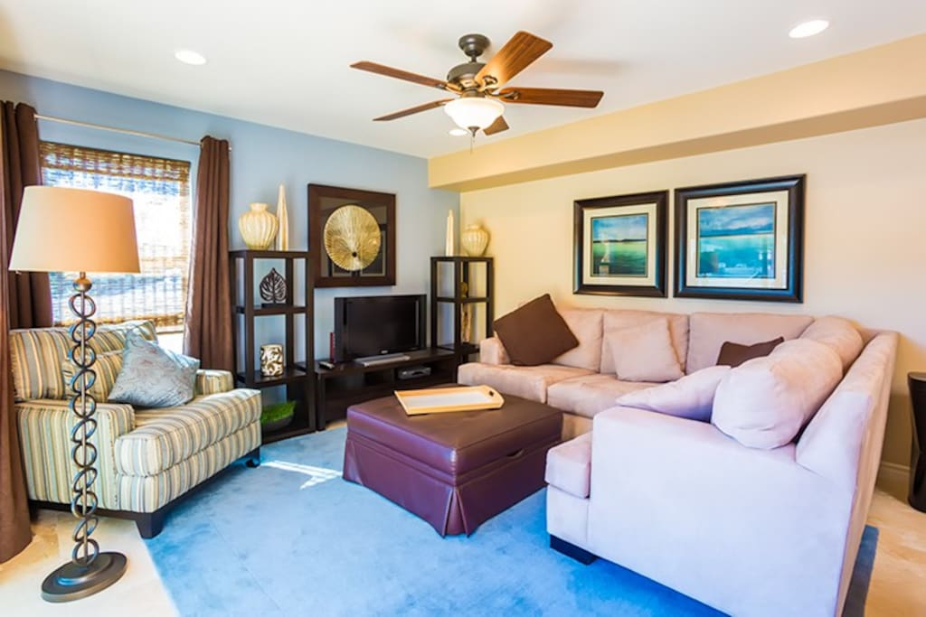 """Living room is comfy with a 38"""" flat screen TV"""