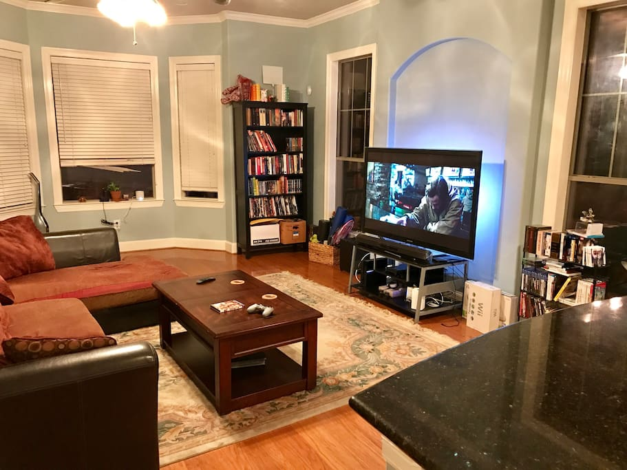 Living room with big screen and large couch