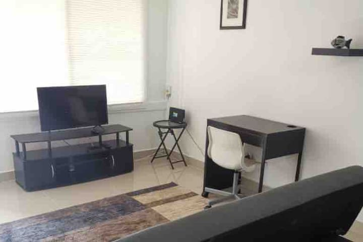 """Nice living room with sofa, desk, 32"""" Smart TV with Cable, Netflix and WiFi."""
