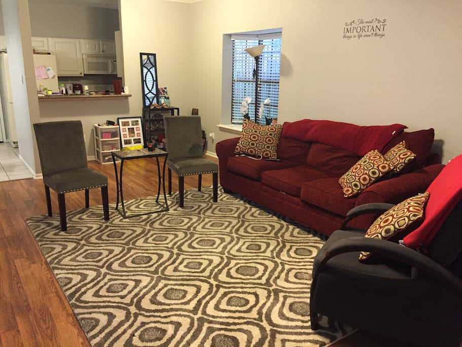 Living room with extra large couch and space for air mattress
