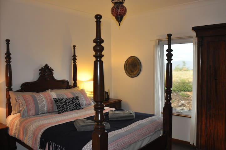 And the fourth bedroom, with a beautiful four-poster double bed.