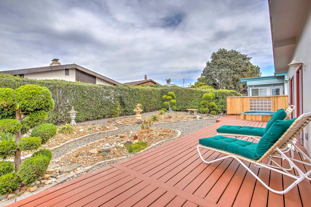 Relax in the backyard with lounge chairs and hot tub.