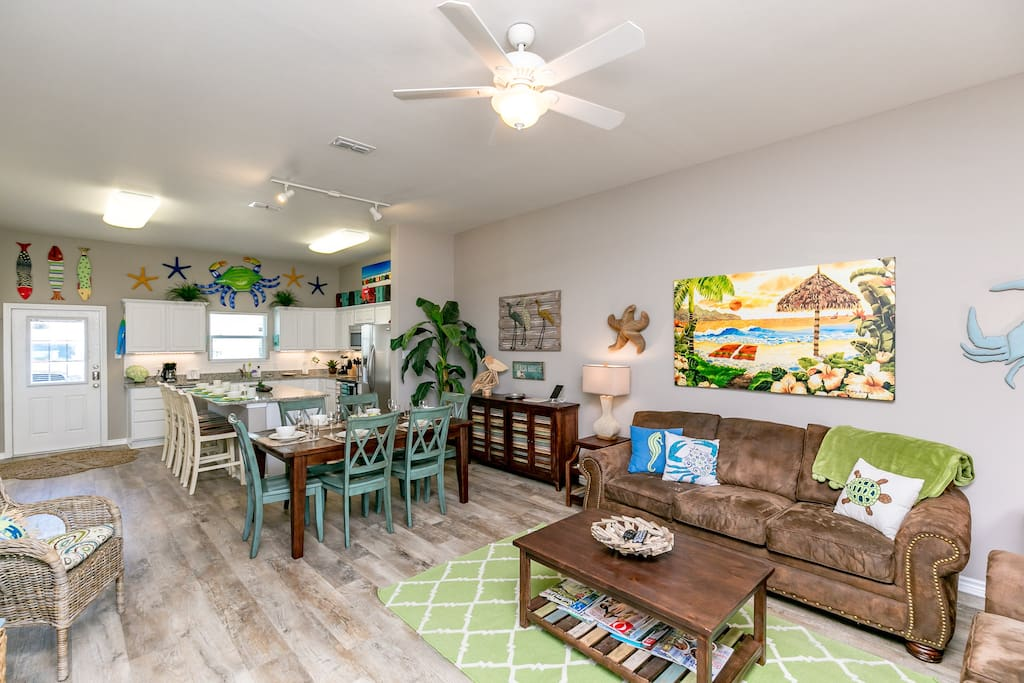 Laidback coastal vibes abound in this open concept gathering space.