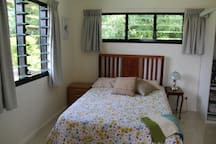 Main bedroom. Plenty of ventilation with the louvred windows