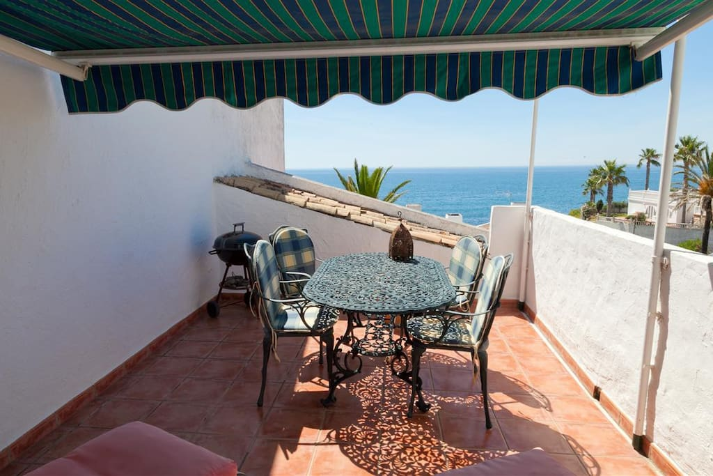 Terrace dining area with great sea views
