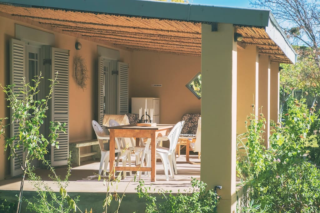 Cosy veranda with dining space and comfortable chairs to read.