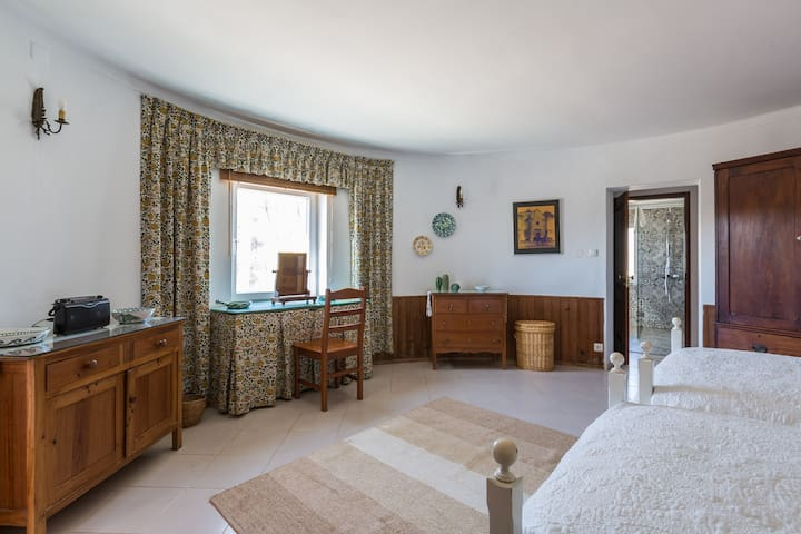 There is plenty of storage in the villa - the dressing table looks out over the orchard
