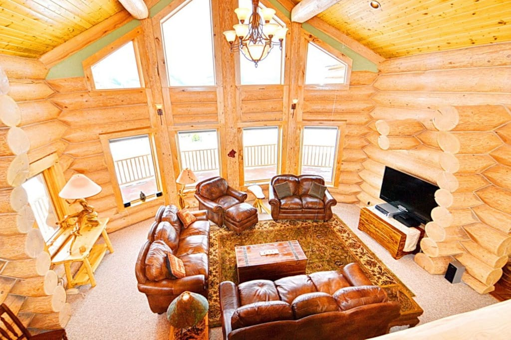 The main living room offers vaulted ceilings and amazing views!