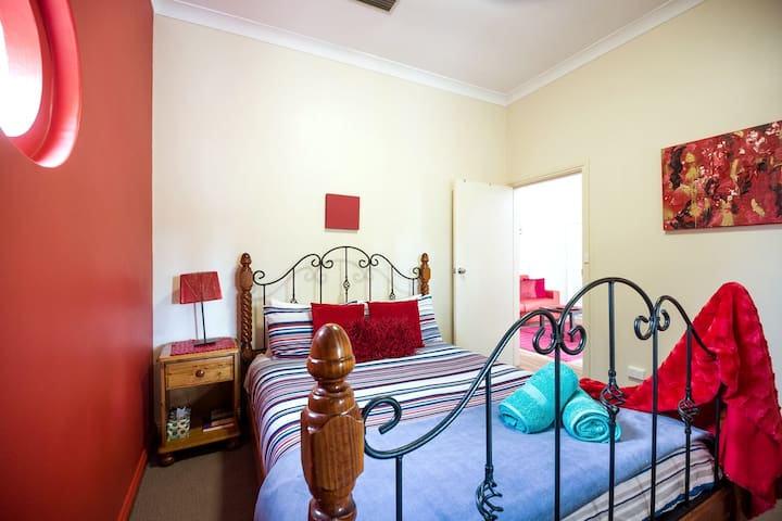 bedroom 3, queen bed, private entrance out to covered balcony