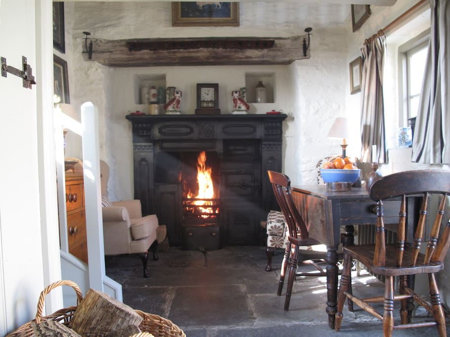Poppy sitting room with old range and open fire