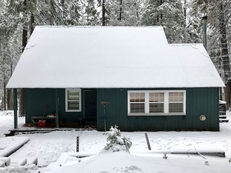 Cabin dusted with snow in winter
