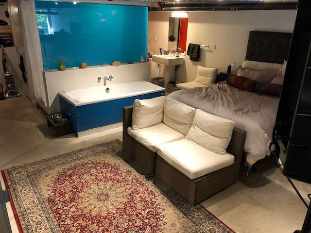 LOFT STYLE BEDROOM WITH EXPOSED BATH TUB