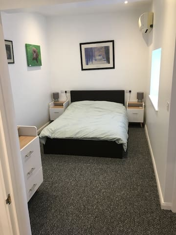 Double bed, half length hanging wardrobe, chest of drawers and air-conditioning on a timer in the summer.