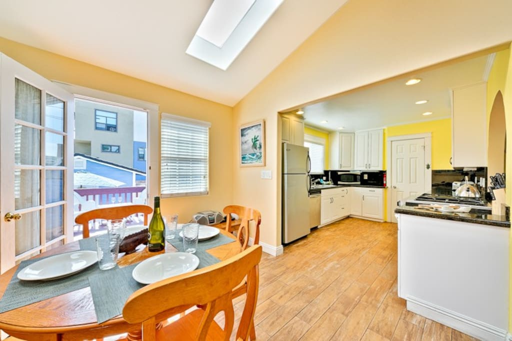 Easy outside access and a peak into the kitchen from the dining area.
