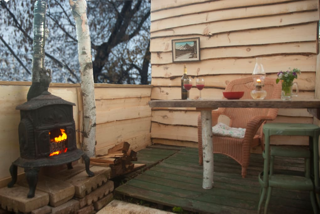 Tiny outdoor shelter attached to shed behind the studio.  The shed has room for your gear as well as kindling and firewood for sitting by the little antique stove on a starry night.