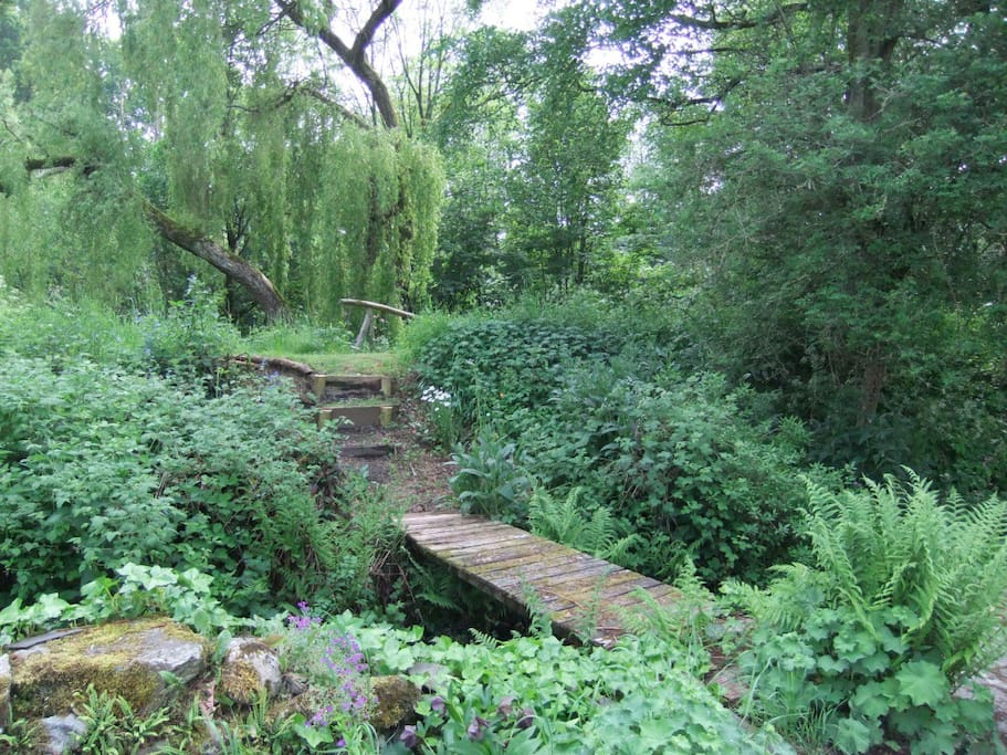 Bridge over mill race to lawn and river