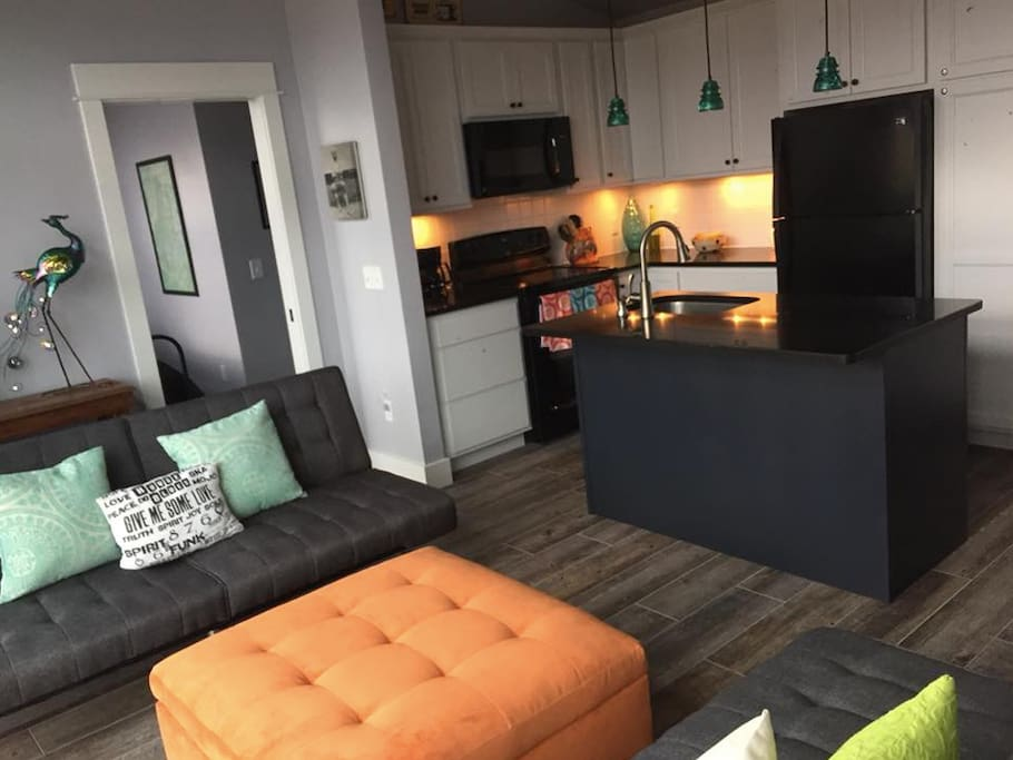 The living room and kitchen are open concept. Kids who are lucky enough to sleep on the futons get the feeling of being in a planetarium with wide open views of the night sky and stars.