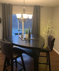 Cozy duplex with WiFi, home office & wooded view!