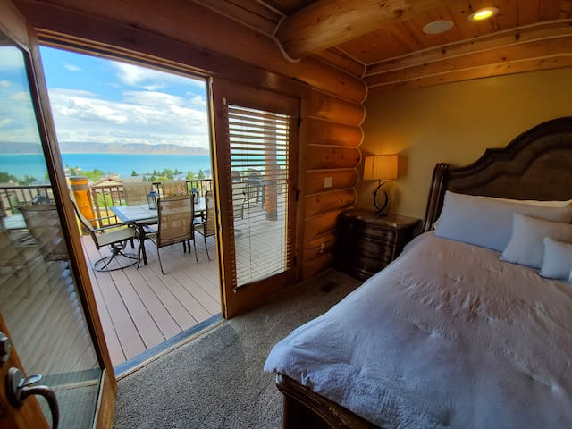 Master bedroom has double french doors out to the main deck overlooking the beautiful lake.