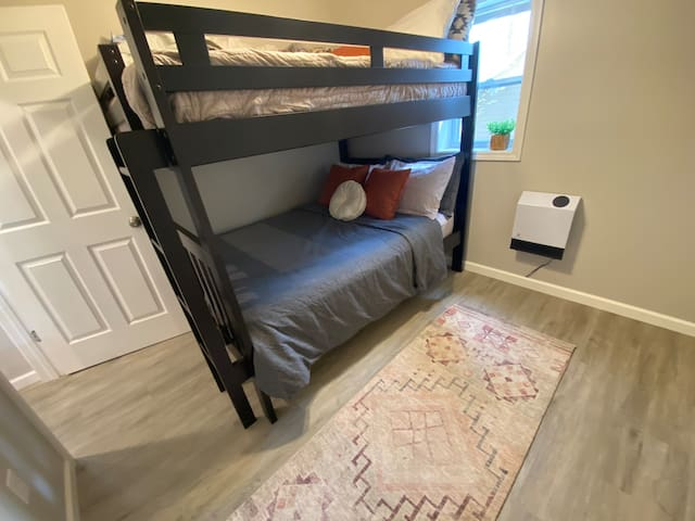 This bedroom has a good size closet and plenty of dresser space for your stay!