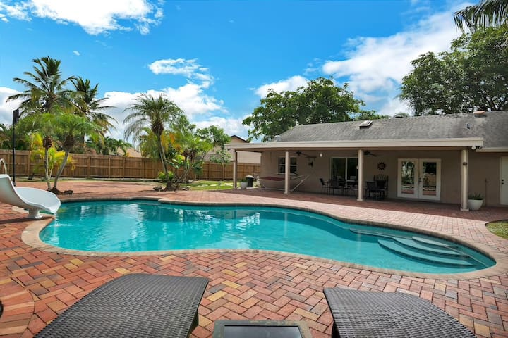 Enjoy the pool surrounded by beautiful trees in a huge, private backyard.