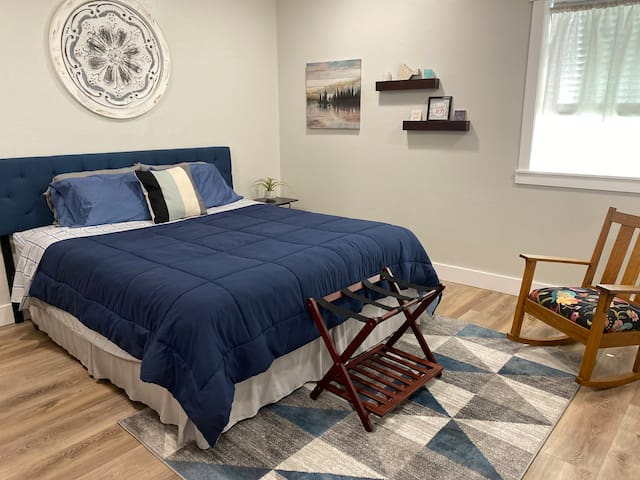 Comfortable King size bed and vintage mission style rocker