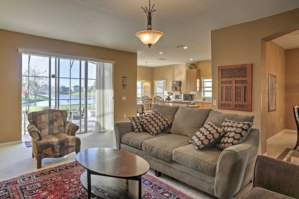 Enjoy comfortable furnishings and lake views from the living room.
