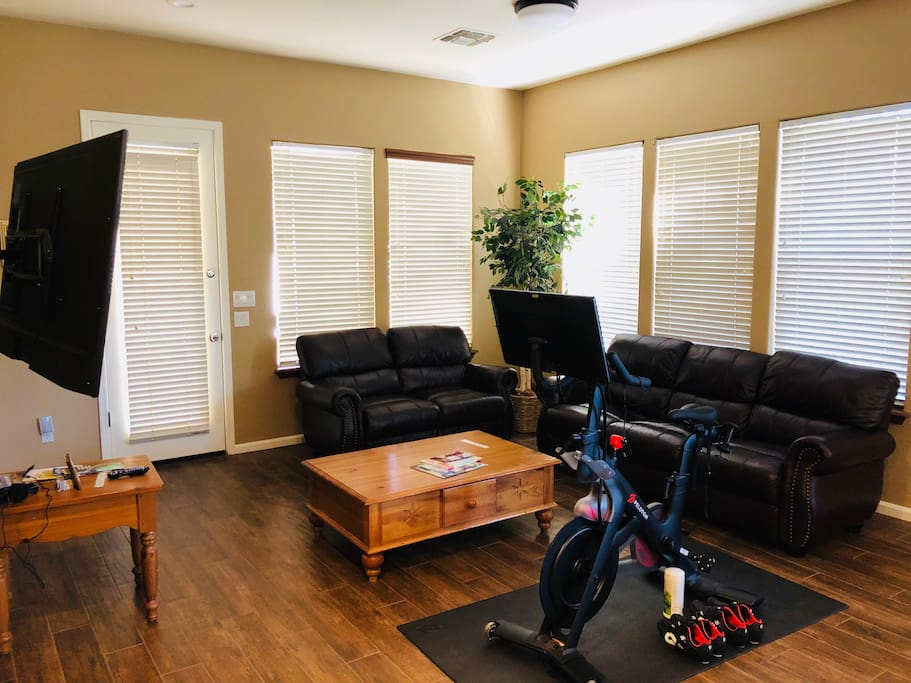 Family room with plenty seating area and large Samsung 4K TV