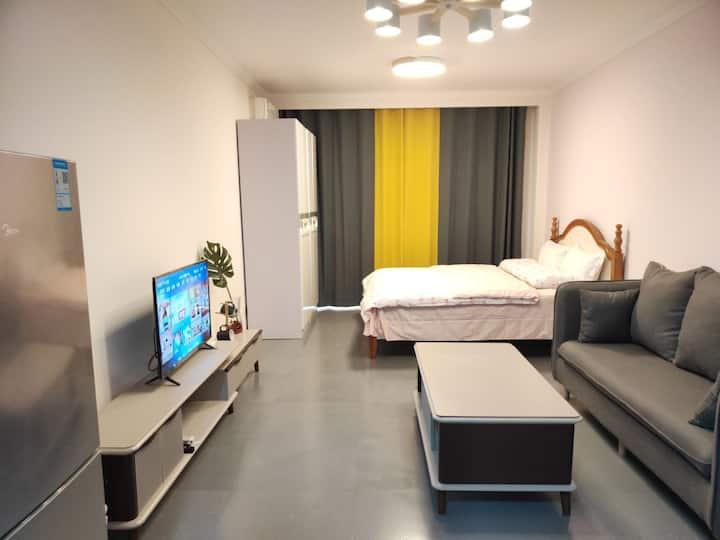 丁香公寓209:火车站、万象汇、美食街中间,电梯乳胶弹簧大床房整租